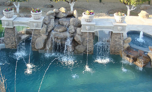 Gunite Swimming Pool With Lazy River, Grotto, Scuppers And Sheer Descents
